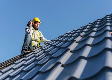 man-working-roof-long-shot
